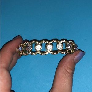 Gold bracelet with silver jewels